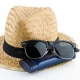 image of sunglasses sitting on a hat